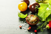 Fresh grape tomatoes with salade leaves and salt — Stock Photo