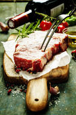 Raw beef steak and wine — Stock Photo