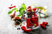 Chili peppers with herbs and spices — Stock Photo
