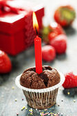 Chocolate muffin with candle — Stock Photo