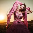Attractive romantic woman on beautiful pink dress pose outdoor. — Stock Photo