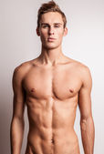 Attractive young undressed man model. — Stock Photo
