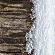 Stock Photo: Wooden fence in the snow