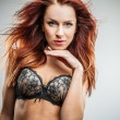 Young sexy redhead model in lingerie - Stock Photo