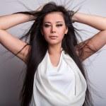 Beautiful woman posing in studio — Stock Photo