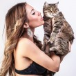 Beautiful woman with a cat. — Stock Photo