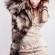 Portrait of attractive stylish woman in fur against grey background. — Stock Photo #18355497