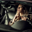 Stock Photo: Luxury woman in a car.