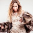 Portrait of attractive stylish woman in fur against grey background. — Stock Photo #18702911