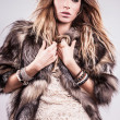 Portrait of attractive stylish woman in fur against grey background. — Stock Photo #18702921