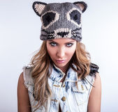 Young sensual model woman on cat hat pose in studio. — Stock Photo