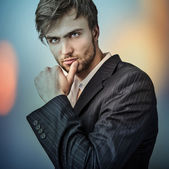 Elegant young handsome man..Multicolored digital painted image portrait of men face. — Stok fotoğraf