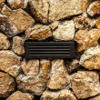 Old rusty dirty ventilation grid embedded in stone wall. — Stock Photo