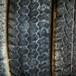 Old tires as background. - Stock Photo
