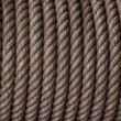 Twisted rough rope. Background photo. - Stock Photo