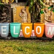 """Welcome"" on colorful garden pot. - Stock Photo"