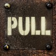 Pull sign on old metal door. — Stock Photo #23495421