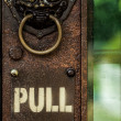Pull sign on old metal door. — Stock Photo
