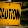 Road sign with a caution concept. - Stock Photo