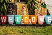 """Welcome"" on colorful garden pot. — Stock Photo"