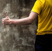 Man hand sign on old stone wall background. — Stock Photo