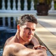 Royalty-Free Stock Photo: Portrait of attractive man at swimming pool.