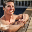Royalty-Free Stock Photo: Adult smiling attractive man at the swimming pool.