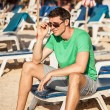 Adult man on the beach. - Stock Photo