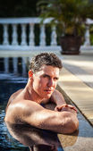 Portrait of attractive man at swimming pool. — Stock Photo