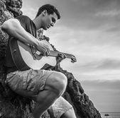 Romantic man play on classic guitar. Black-white photo. — Stock Photo