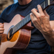 Close-up of man hand with a classical guitar on motion. — Stock Photo