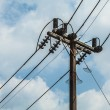 Electric pole with wires with blue sky — Stock Photo #23593975