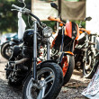 Row of motorcycles parked together - Stock Photo