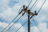 Electric pole with wires with blue sky — Stock Photo