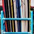 Surfboards lined up on the beach - Stock Photo