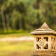Lantern in a garden stone — Stock Photo
