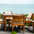 Cafe on the beach of tropical island - vacation background - Foto Stock