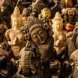 Ancient traditional figurine's from stone. Background photo. — Stock Photo
