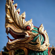 Stock Photo: Dragon statue with blue sky