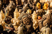 Ancient traditional figurine's from stone. Background photo. — Photo
