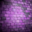 Colored violet brick wall background — Stockfoto
