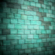 Stock Photo: Colored brick green wall background