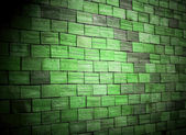 Colored green brick wall background — Stock Photo