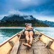 Young man sleeping on the boat — Stock Photo