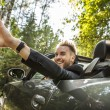 Elegant young happy man in convertible car outdoor.   — Stock Photo