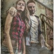 Retro styled grunge portrait of young positive couple. — Foto Stock