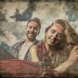 Retro styled grunge portrait of young positive couple. — Stock Photo #33349501