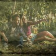 Retro styled grunge portrait of young positive couple. — Stock Photo #33350165