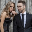Portrait of young attractive couple posing outdoor dressed in black fashionable clothes. — Stock Photo