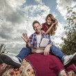 Positive young couple spending time outdoors. — Stock Photo #33918341